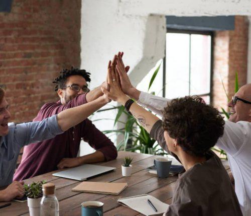 business-team-high-fiving