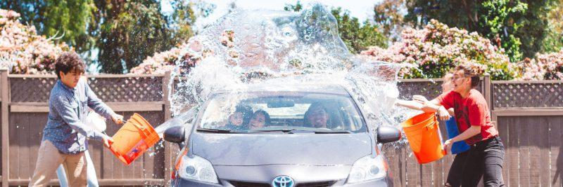 young-people-having-fund-washing-car