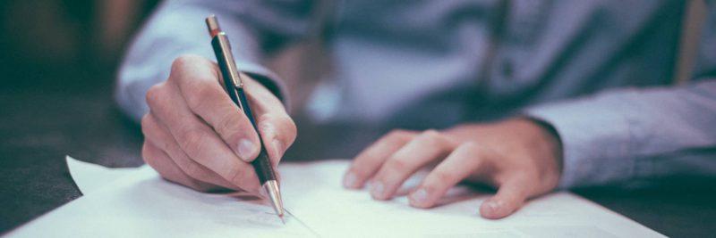 man-writing-letter