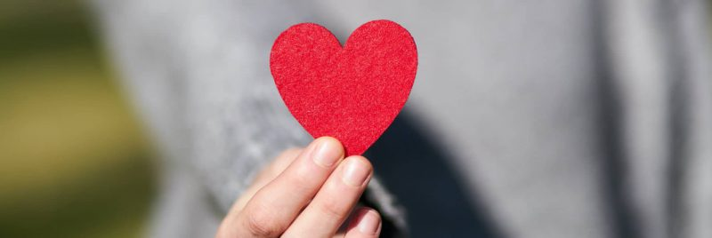person-holding-paper-heart