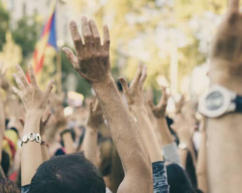 group-raising-hands