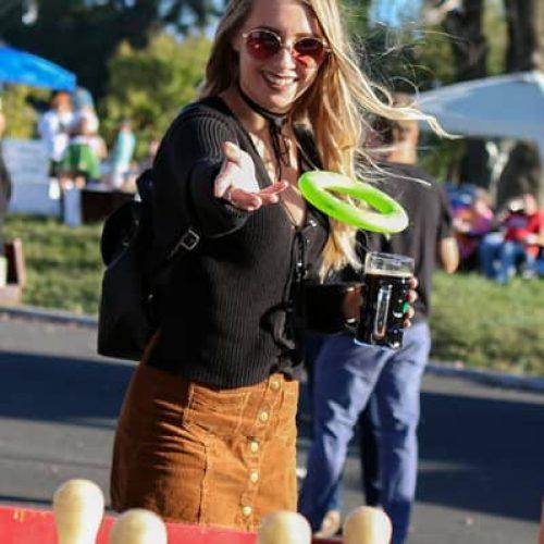 girl-throwing-frisbee-at-fair