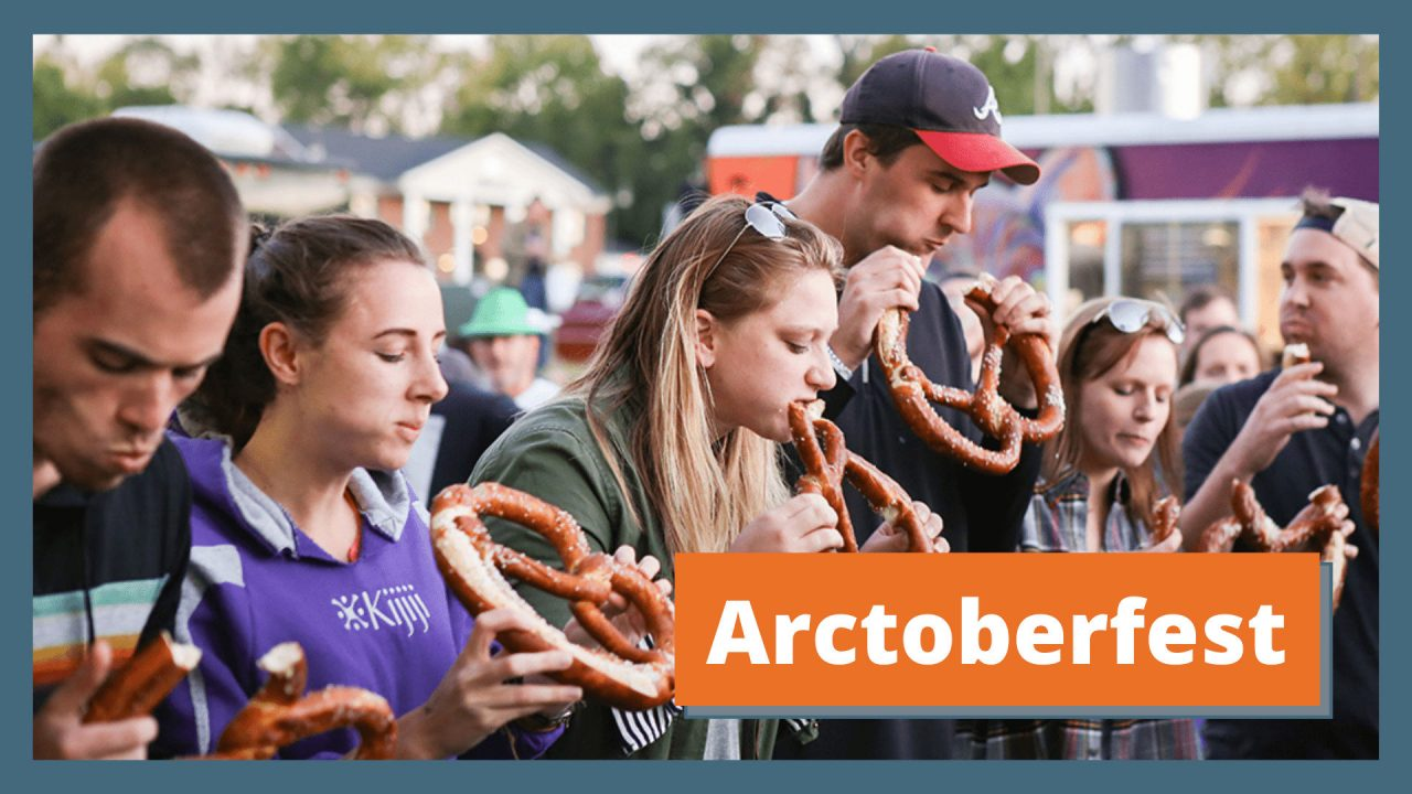"""6 young, white people line up outside while holding giant pretzels. Their mouths are stuffed with pretzel during a pretzel eating contest. Text reads """"Arctoberfest"""""""