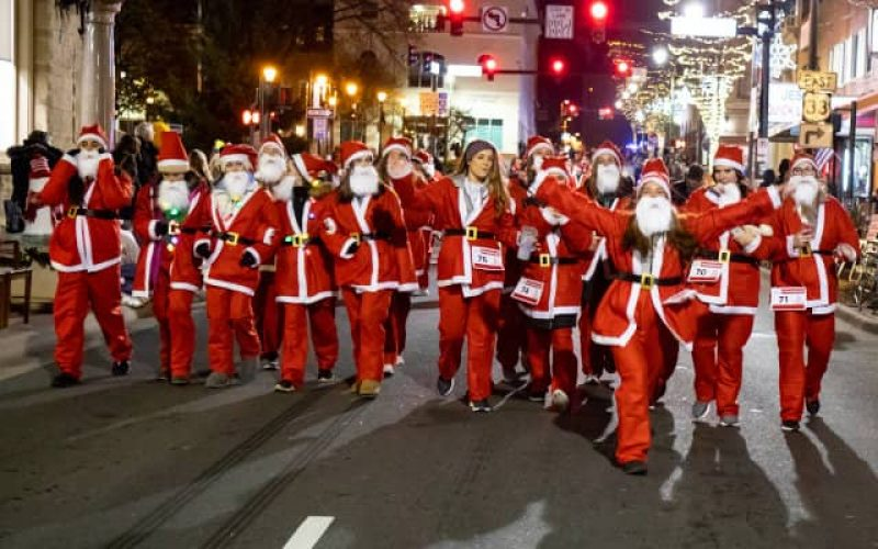 group-of-santa-walking-down-street