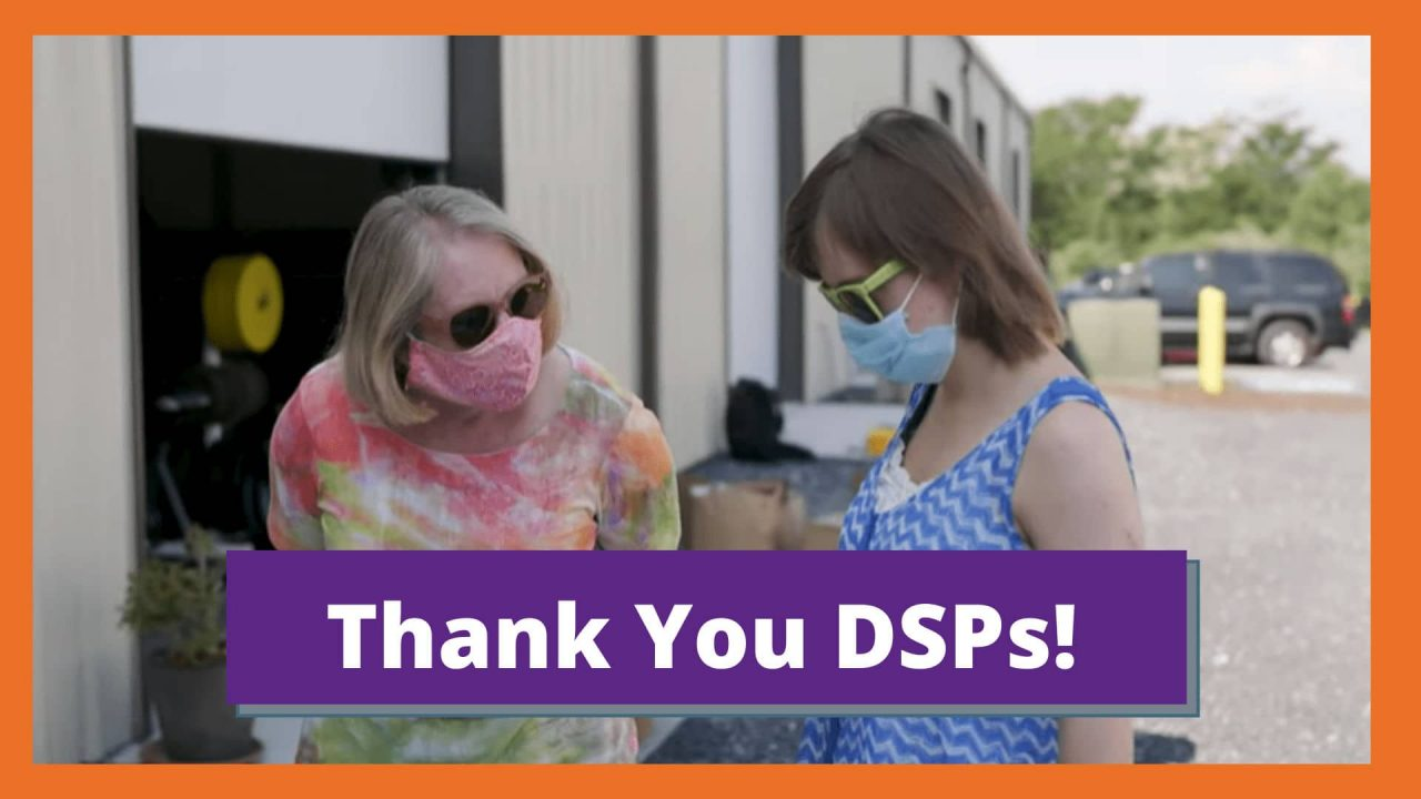"""An older white woman with sunglasses and a mask on leans in to listen to a young white woman with a mask on who is showing her a page from her coloring book. Text reads """"Thank You DSPs!"""""""