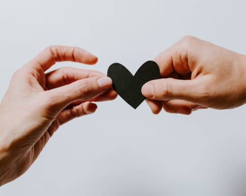 two-hands-holding-paper-heart