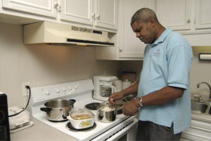 man-cooking-at-stove