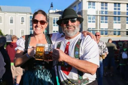 two-people-having-fun-at-arktoberfest