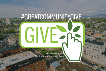 """Background is a birds eye view of downtown Harrisonburg buildings with the Great Community Give Logo in the center. Text reads """"#GreatCommunityGive, an initiative of The Community Foundation"""""""